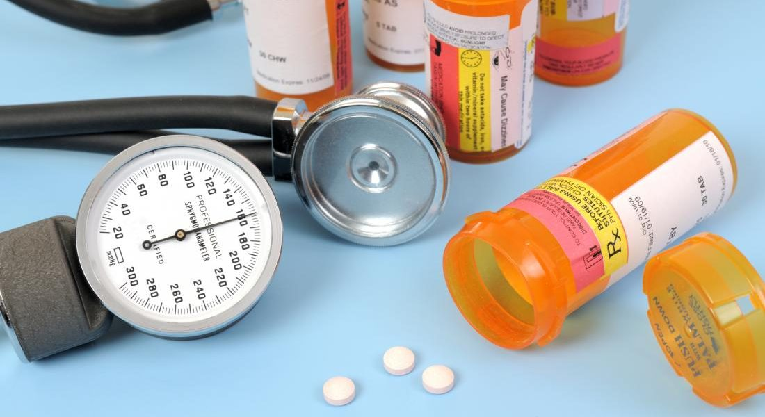 bottles-of-pills-with-a-stethoscope-and-blood-pressure-meter